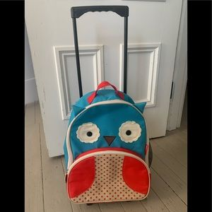Skip hop turquoise and red owl toddler roller bag